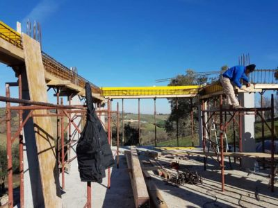 Anchoring a Beam at a new house construction site in Le Marche
