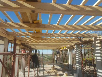 Adding cross beams to ground floor structure for a new house in Le Marche