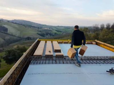 Installing Poroton Blocks at new house construction in Le Marche