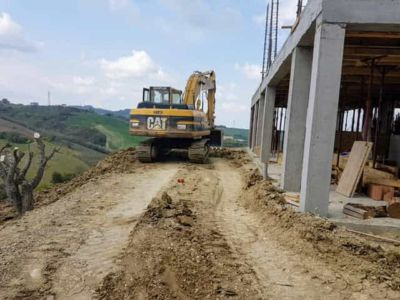Leveling Behind the House at new house construction site in Le Marche