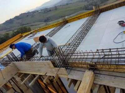 Linking the Rebar Together at new house construction in Le Marche