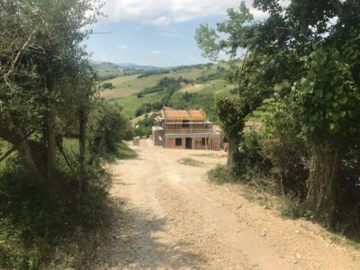 Looking Down the Driveway of a new house being built in Le Marche, Italy