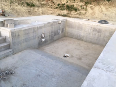 Looking Down the Pool at new house being built in Le Marche