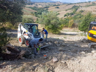 Machinery Down the Hill behind a new house being built in Le Marche, Italy