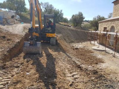 Making the Hill Less Steep in Front of a new house being built in Le Marche, Italy