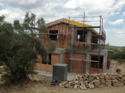 On Neighbors Land Looking North of a new house being built in Le Marche, Italy