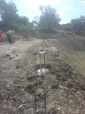 Pilings Poured to support retaining wall at a new house construction site in Le Marche