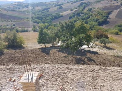 Portico Column and View Across Valley at a new building site in Le Marche, Italy