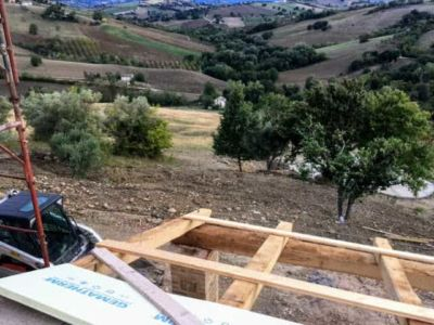 Portico Roof Cross Beams in Place at a new building site in Le Marche, Italy