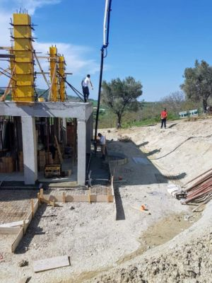 Pouring Sidewalk Concrete surrounding a new house being built in Le Marche