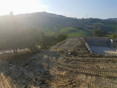 Preliminary Leveling Near Pool at house being constructed in Le Marche