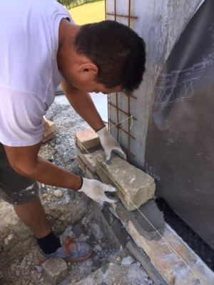 Ready to Place the First Stone on a new stone house in Le Marche