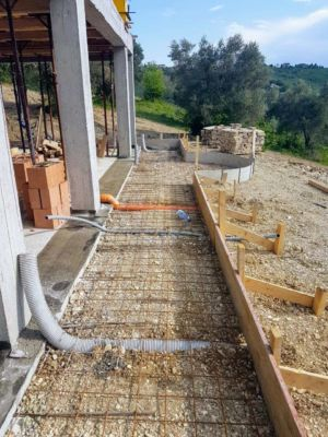Ready to Pour Concrete surrounding a new house being built in Le Marche