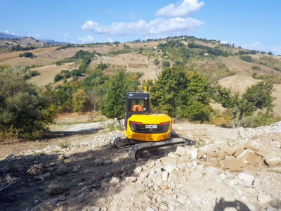 Reshaping the Terraces behind a new house being built in Le Marche, Italy