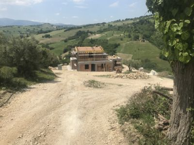 Roof Work Continues of a new house being built in Le Marche, Italy