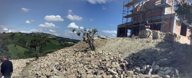 Slope Behind House under construction in Le Marche