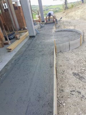 Smoothing Concrete surrounding a new house being built in Le Marche