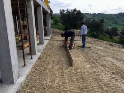 Starting Sidewalk Form Behind House at a new house being built in Le Marche Italy
