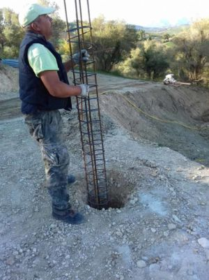 Steel Reinforcement Being Placed to support retaining wall at a new house construction site in Le Marche