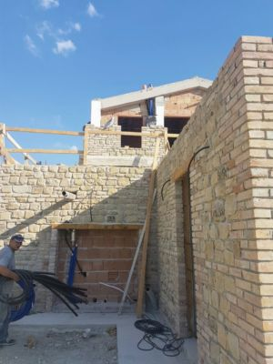 Stone on Ground Floor Exterior of a new house being built in Le Marche