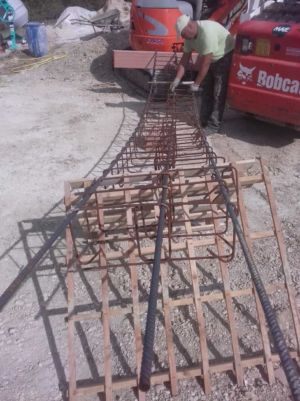 Structural Steel for Pilings to support retaining wall at a new house construction site in Le Marche
