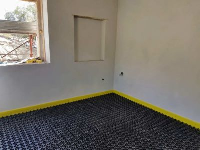 Study with Underfloor Heating Base inside a new house being built in Le Marche