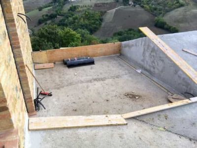 Terrazza Toward the Back of a new house being constructed in Le Marche