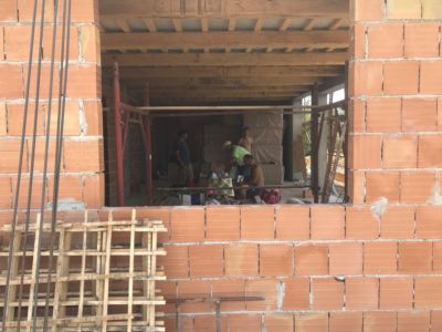Through the Kitchen Window to the Main Room of a new house being built in Le Marche, Italy