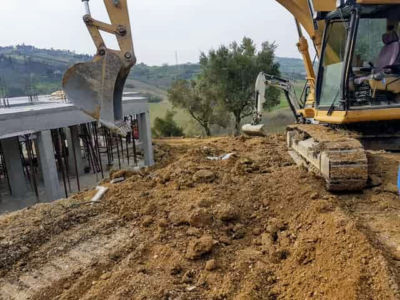 Two Diggers Working as part of house construction project in Le Marche