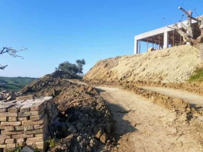 Unfinished Slope Behind House being constructed in Le Marche