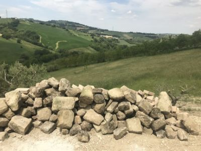 Wall Stone Ready to Go at site of a new house being built in Le Marche, Italy