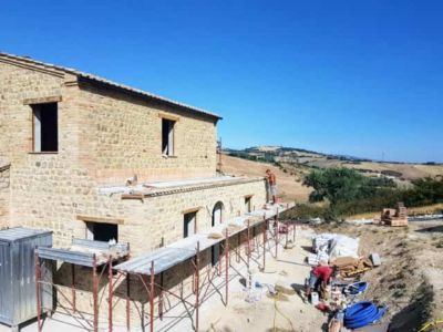 Work to Prepare for Small Roof Sections on a new stone house being built in Le Marche, Italy.