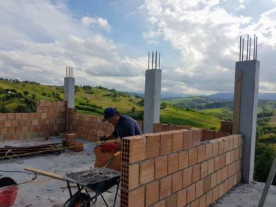 Working on Bathroom Wall  of a new house being built in Le Marche