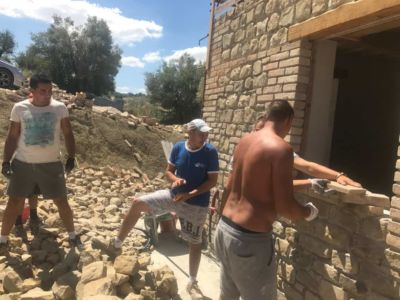 Working on Brick Layout of our new house under construction in Le Marche