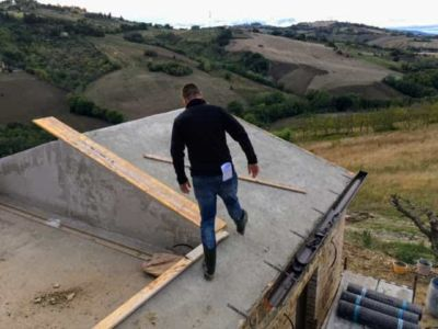 Working on Roof Near Terrazza on the top floor of a new house in Marche