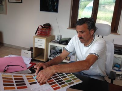 Working to Pick Beam Color in a design planning meeting for a new house in Le Marche
