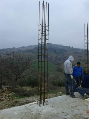 Finishing a Column at new house construction site in Le Marche