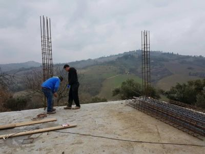 Structural Engineer Checking Column at new house construction site in Le Marche