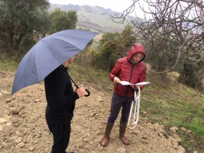 Builder and Geometra on site of new construction in Le Marche