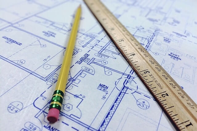 house blueprint of floorplan with pencil and ruler
