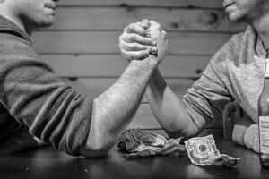 Arm wrestling to suggest negotiation