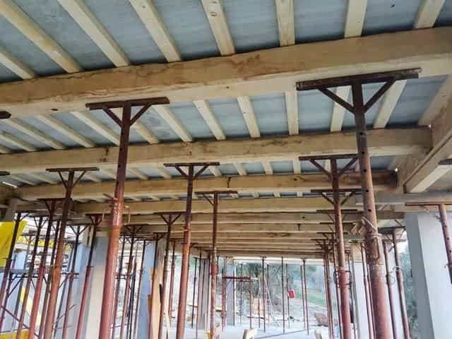 Ceiling composite panels above beams