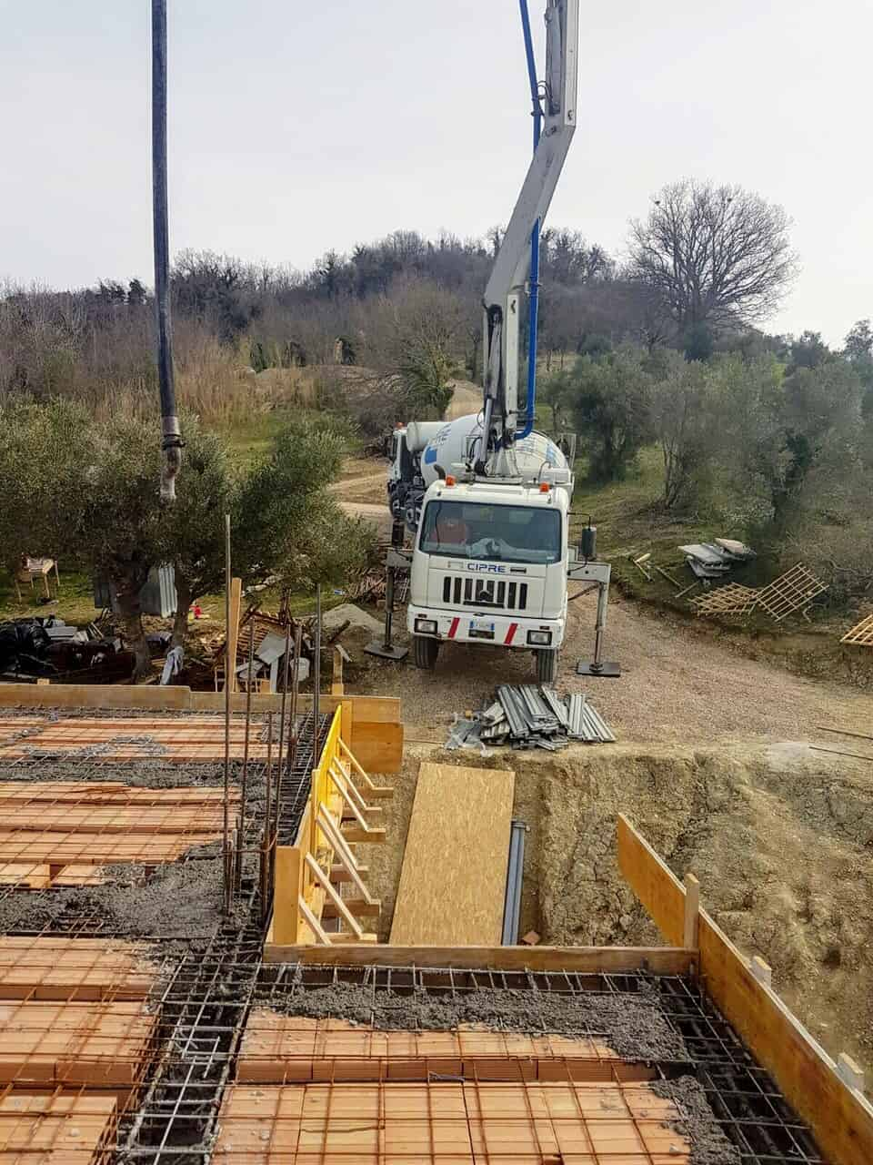 Concrete Crane and Truck at new house construction site in Le Marche