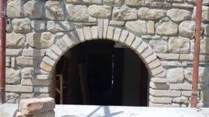 Stone arch over door