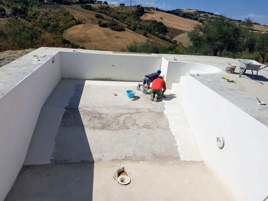 Working to Seal the Pool Concrete